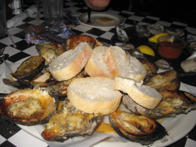 Acme Chargrilled Oysters Appetizers oysters, white wine, romano cheese ...