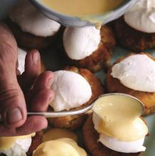 Poached Eggs & Satsuma Hollandaise over Crab Cakes