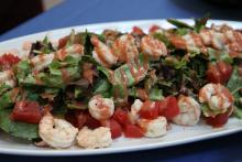 Beer Poached Vermillion Bay Sweet Shrimp over Mixed greens
