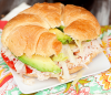 Turkey With Avocado And Cream Cheese Croissant Sandwich